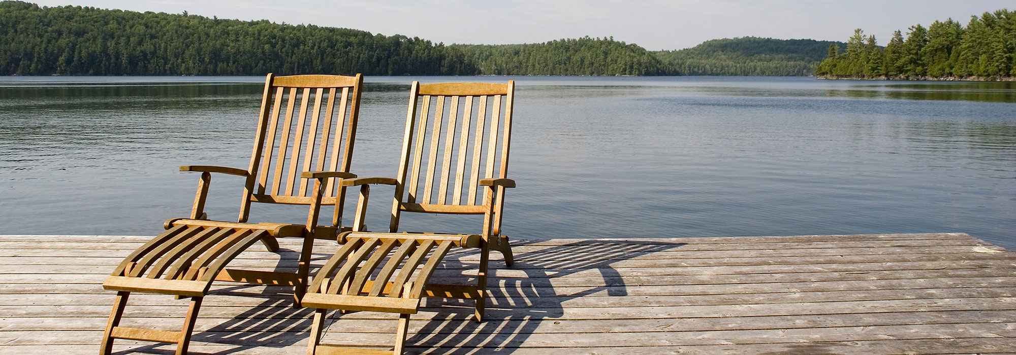 home-banner-lake-side-deck-chairs-pleasant-view-realty-plymouth-wi